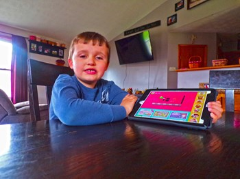 Child plays with tablet