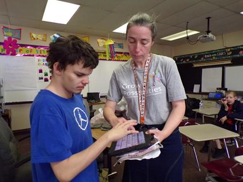 Teacher with student using an iPad at Open Door