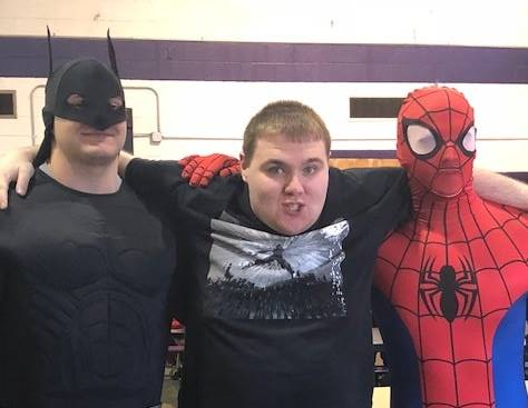 Student with Batman and Spiderman