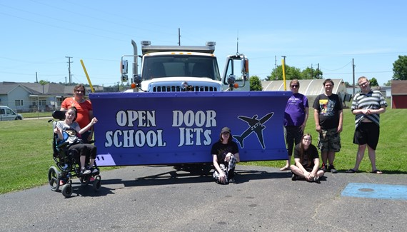 Students with a truck plow