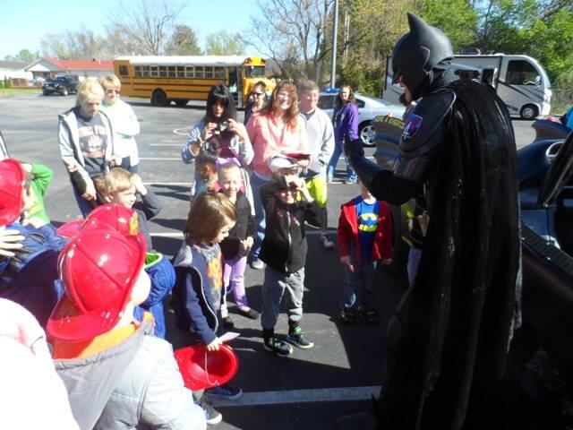 Batman talks to preschool students