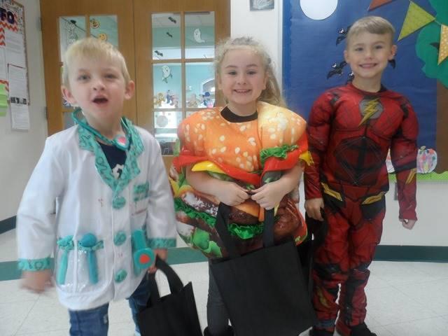Students in Halloween costumes