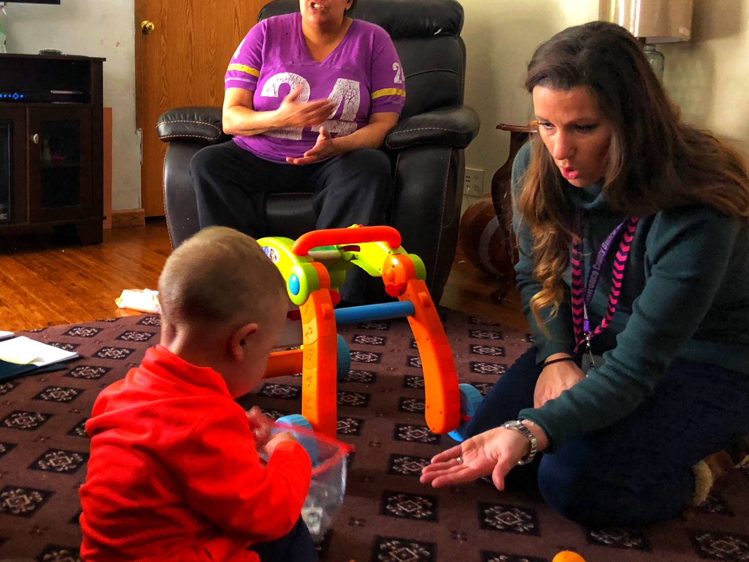 Developmental specialist meets with family