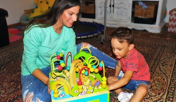 Parent works with child enrolled in the early intervention program