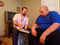 Service and Support Administrator meeting with a client